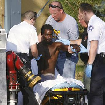 William Sturdivant is helped on to a stretcher after coming down from the Clear Channel Communications building tower in Tulsa (AP)
