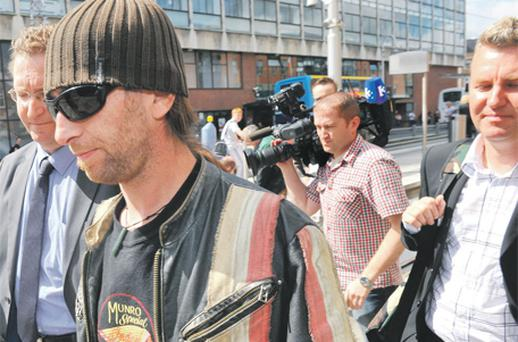 Anne Scattergood's sons Paul, Damien and Francis outside Dublin City Coroner's Court yesterday
