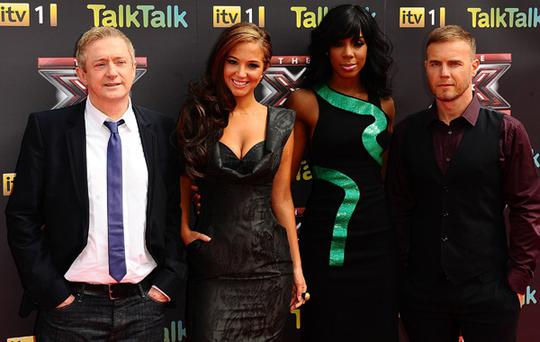 The X Factor judges Louis Walsh, Tulisa Contostavlos, Kelly Rowland and Gary Barlow arriving for the X Factor Press Launch.