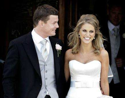 SPECIAL DAY: Brian O'Driscoll and Amy Huberman leave the church as a married couple. Photo: Steve Humphreys