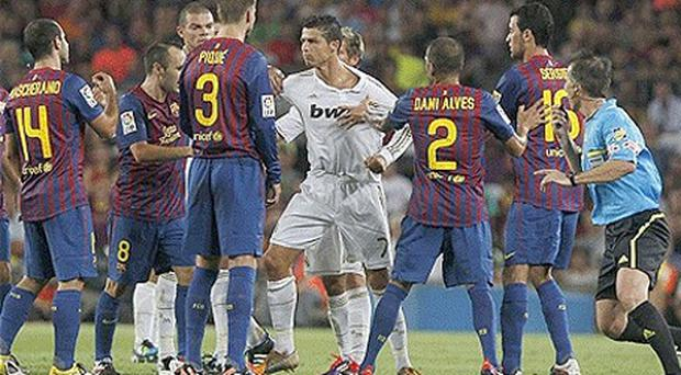 Best of enemies: No love lost between Barcelona and Real Madrid as another El Clasico ends up with a brawl and red cards. Photo: AP