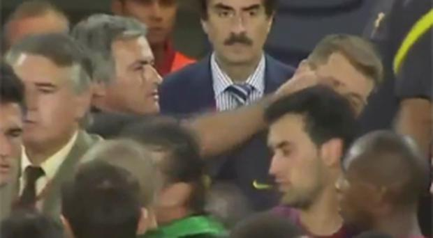 Jose Mourinho tugs the ear of Barcelona's assistant coach Tito Vilanova. Photo: YouTube