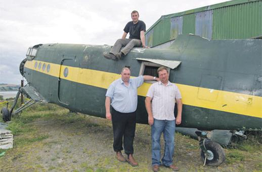 Robert Bennett (left), his son Richard (top) and Andrew Wilson with the Antonov An-2 aircraft in Courtmacsherry, Co Cork, yesterday