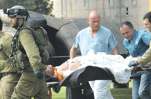 A soldier injured in yesterday's attack is brought to hospital in Beersheeva, Israel