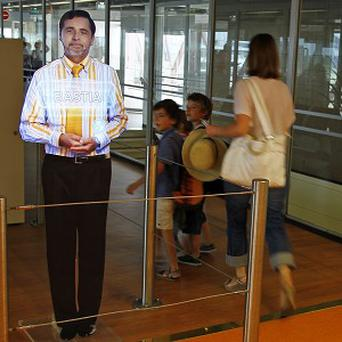 A Parisian airport has been experimenting with a 'virtual' boarding agent (AP Photo/Francois Mori)