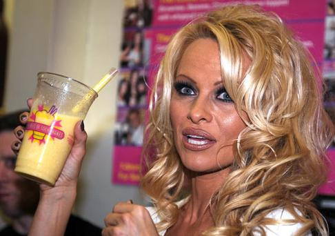 Spokesperson for PETA (People for the Ethical Treatment of Animals), actress Pamela Anderson creates the first all-vegan shake at Millions of Milkshakes in West Hollywood, California on April 9, 2010 . AFP PHOTO / GABRIEL BOUYS (Photo credit should read GABRIEL BOUYS/AFP/Getty Images)