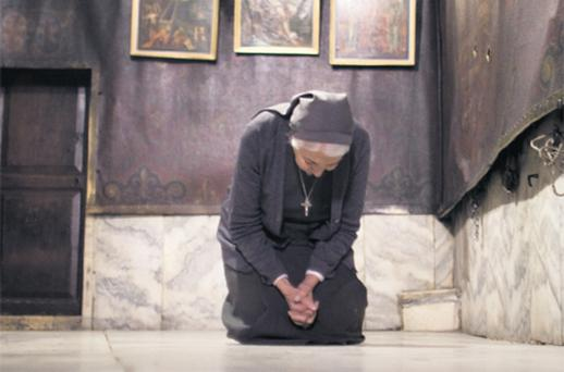 A nun prays in Bethlehem . . . but a US reader suggests the church in Ireland has lost its way