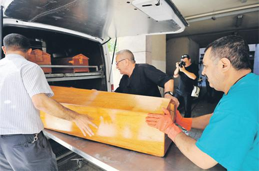 The bodies of Marion Graham and Kathy Dinsmore being removed from the morgue in Turkey