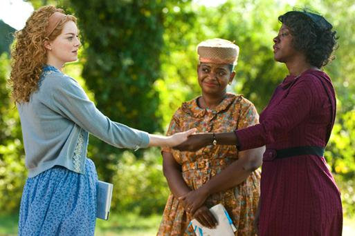 Emma Stone, Octavia Spencer and Viola Davis in a scene from The Help