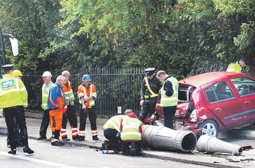 ESB engineers at work on the supply following a crash which resulted in a large ESB lighting pole being knocked down at Merrion Square, Dublin, recently