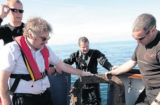 Divers return from the 'Lusitania' with wreckage