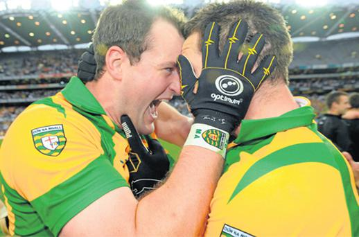 Michael Murphy celebrates with team-mate Kevin Cassidy after beating Kildare