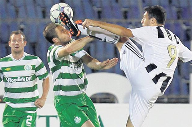 Stephen Rice of Shamrock Rovers puts his head in where it hurts against Partizan Belgrade's Eduardo during the Europa League play-off second leg in Belgrade last night