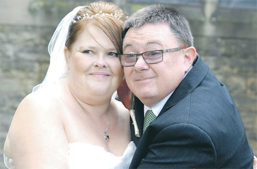Catholic priest Sean Page with Clarice Young after the couple's wedding ceremony in an Anglican church in England