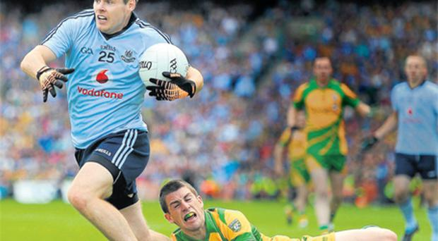 Dublin substitute Kevin McManamon gets away from Paddy McGrath at Croke Park yesterday