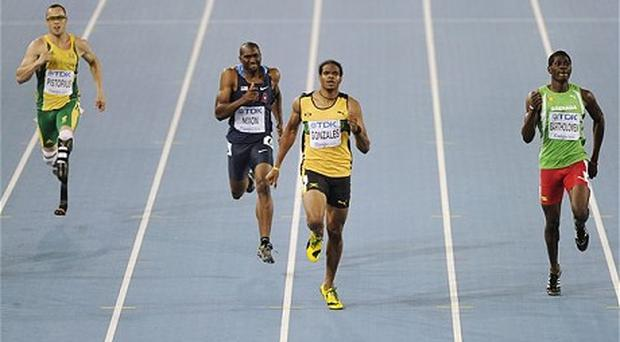 Blown away: Oscar Pistorius fell away from the leaders in the final quarter of the race. Photo: AP