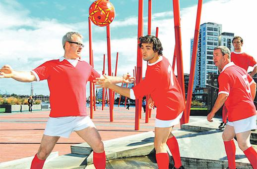 Aidan O'Neill as George Best, centre, with other cast members of 'Dancing Shoes: The George Best Story' limbering up before last night's opening at the Grand Canal Theatre, Dublin