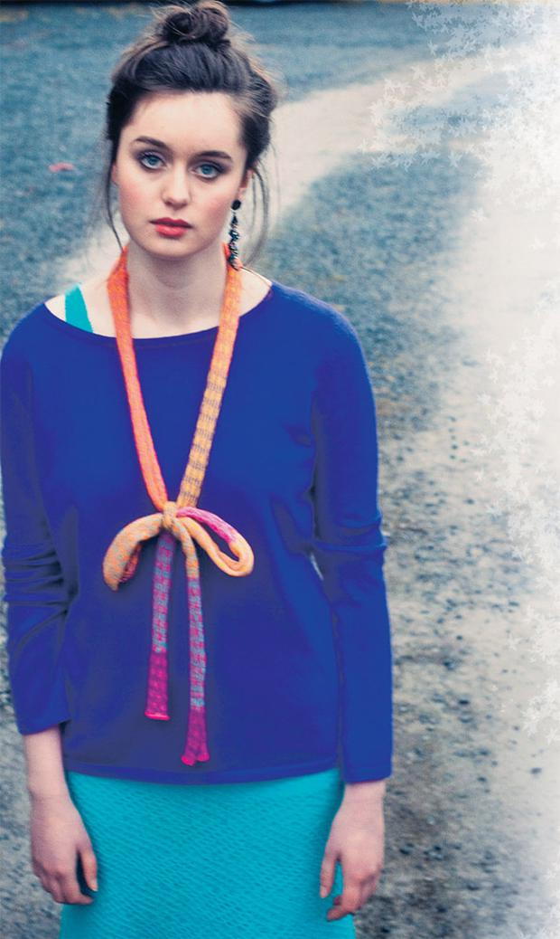 Purple sweater in 100pc cashmere/lambswool, €125; turquoise honeycomb dress, €165 and skinny scarf, worn as bow, €40, all Heather Finn at Project 51, 51 South William Street Dublin