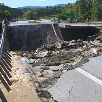 Tropical Storm Irene caused damage and flooding across the East Coast of the US (AP.Rutland Herald)