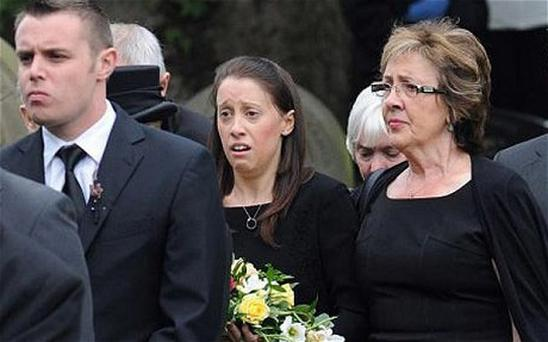 Gemma Redmond (centre) arrives with her mother Coleta Houghton for the funeral of her husband Ian Redmond at St Michael and All Angels Church in Dalton, Skelmersdale