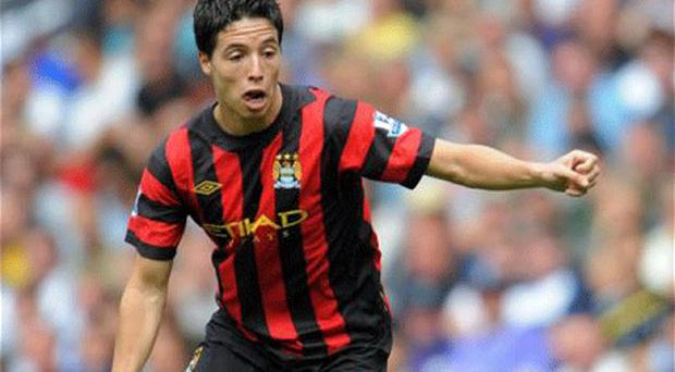 Jumping ship: Samir Nasri feels he is now playing for a side with a genuine chance of winning major trophies Photo: Action Images