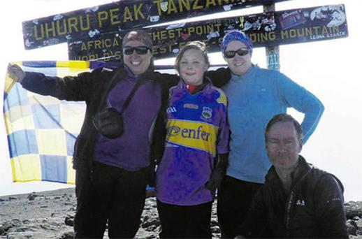Sinead and Sarah O'Neill with Fionnuala McGeever and Ian McKeever after the 11-yearold became the youngest girl to scale Mount Kilimanjaro