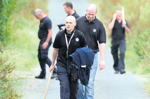 Gardai search for clues following the raid on the couple's home in Saleen, Co Waterford