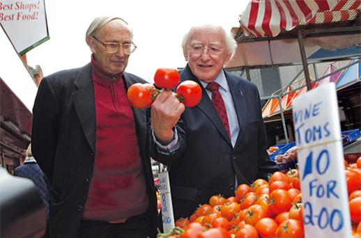 Presidential hopeful Michael D Higgins on a walkabout on Moore Street, Dublin, yesterday, with Noel Gregory