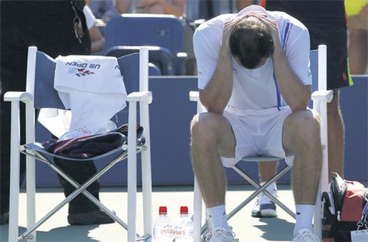Ireland's Conor Niland shows his disappointment after illness forced him to retire during his first round match against World No 1 Novak Djokovic in NewYork yesterday