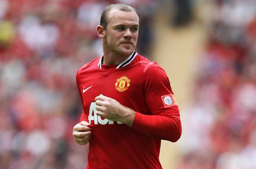 Wayne Rooney headed into the summer with a detailed list of dos and don'ts from Tony Strudwick. Photo: Getty Images