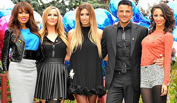 At the launch of BBC Children In Need 'POP Goes The Musical', from left, Jade Ewen, Heidi Range, Stacey Solomon, Peter Andre and Amelle Berrabah. Photo: PA