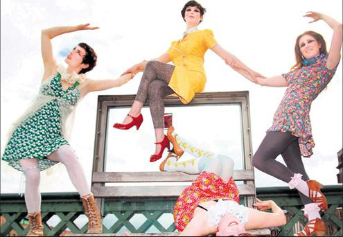 Members of the performance company PaperDolls,
