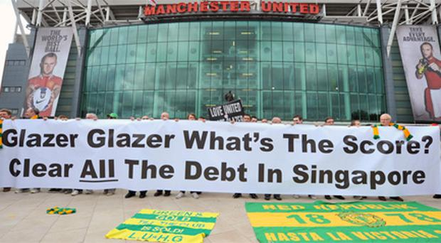 An anti-Glazer protest outside Old Trafford. Photo: PA
