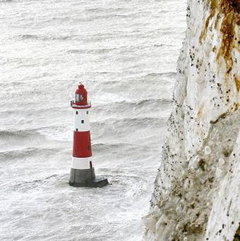 Repainting the Beachy Head lighthouse's distinctive red and white banded colours would cost 45,000 pounds