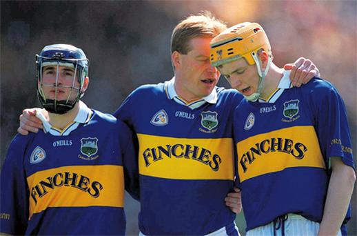 Declan Ryan stands alongside Eoin Kelly and Lar Corbett prior to the Munster Championship clash against Clare. Ten years on, Ryan is looking to both to help Tipperary win consecutive All-Ireland titles for the first time in 56 years