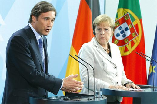 German Chancellor Angela Merkel and Portuguese Prime Minister Pedro Coelho address the media after talks at the Chancellery yesterday during Coelho's first official visit to Germany. Portugal's debt situation was high on the talks agenda