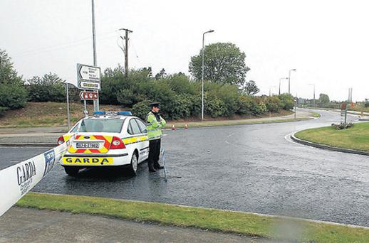 Gardai kept nearby roads closed during forensic examination of the scene