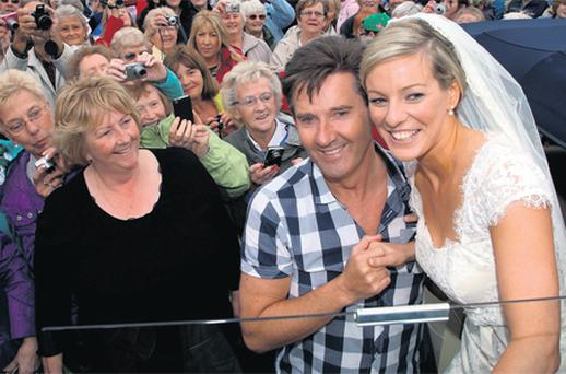 Daniel O'Donnell takes time off stage at the Shore Festival in Donegal to wish the bride-to-be Anne O'Sullivan all the best for her big day