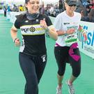 Grainne Seoige and Kathryn Thomas finishing their relay at the Ironman 70.3 at Salthill in Galway. Picture: Philip Cloherty