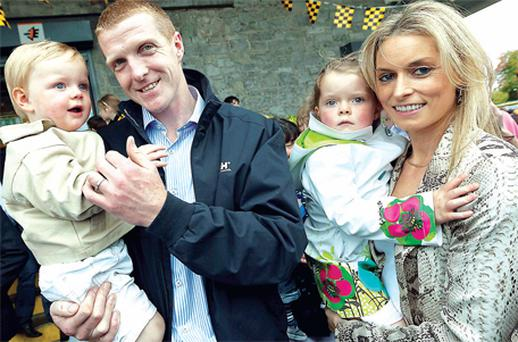 Kilkenny last night hailed its own King Henry the Eighth. Hurling hero Henry Shefflin, who now has eight All-Ireland medals, and his team were given a rapturous welcome home. He is pictured by Dylan Vaughan with wife Deirdre and children Henry Jr and Sadhbh