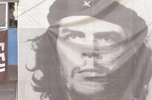 A replica of the image created by Irishman Jim Fitzpatrick of Che hangs from a building in Cuba