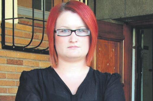 Siobhan McGuirk whose father Kevin and stepmother Kim were both shot dead in South Africa last month, outside court near Johannesburg yesterday