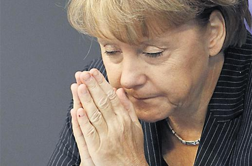 German Chancellor Angela Merkel during a session of the Bundestag in Berlin yesterday