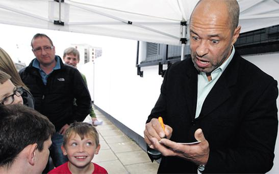 Irish football legend Paul McGrath signs autographs at the unveiling of an art installation at Inchicore Sports Centre, Dublin, yesterday