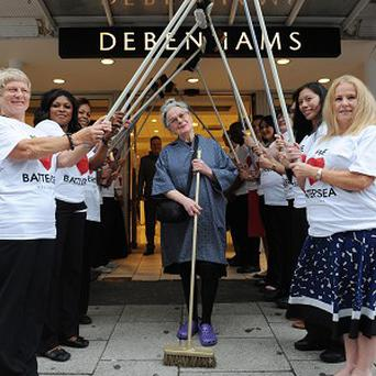 Brave Brenda outside the Debenhams store in Battersea which she helped defend during rioting