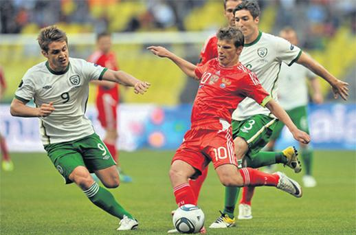 Russia's Andrei Arshavin in action against Ireland's Kevin Doyle, left, and Stephen Ward during this week's Euro 2012 qualifier in Moscow
