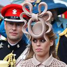 Princess Beatrice's hat, right, came in for much criticism