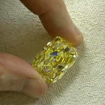A huge yellow diamond known as the Golden Eye and seized in an Ohio money laundering investigation has been auctioned (AP)