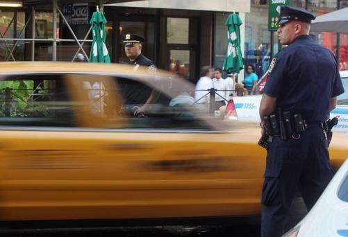 Police check cars in Manhattan as security is tightened. Photo: Getty Images