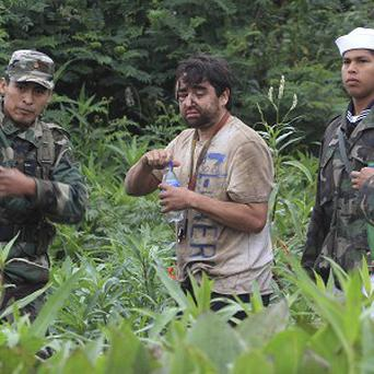 Minor Vidal, centre, who survived a plane crash in the Bolivian rainforest (AP)